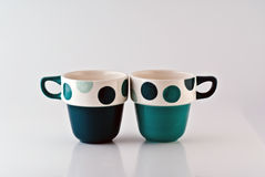 Two Mugs. Two Colorful mugs side by side Stock Image