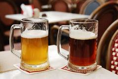 Two mugs of beer Stock Photography