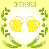 Two mugs of beer, barley stalks and branches of hops, the Oktoberfest Royalty Free Stock Photo
