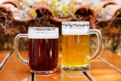 Two mugs of beer on a table at an outdoor cafe Royalty Free Stock Photography