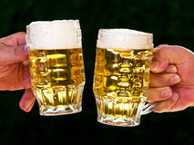 Two mugs of beer with us beer foam Stock Photo