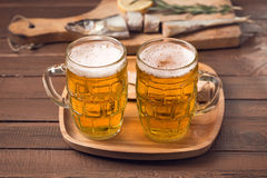 Two mugs of beer Stock Images
