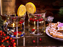 Two mugs with Christmas drink, decorated lemon. Stock Photography
