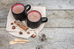 Two mugs of cocoa and nuts on beige towel Stock Photos