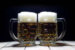 Two Mugs of Cold Beer Are the Best Way to Quench Thirst Royalty Free Stock Image