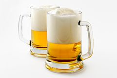 Two mugs of delightful amber beer Stock Photos
