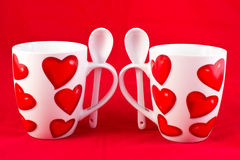 Two mugs with hearts Royalty Free Stock Images