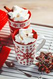 Two mugs with hot drink and marshmallows on the top. Christmas colorful still life. Cozy festive mood. stock image