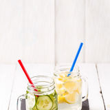 Two mugs of infused detox diet refreshing waters: with cucumber and lemon Stock Image