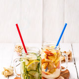 Two mugs of infused detox diet refreshing waters - first with cucumber and lemon, second with lemon and peach Stock Images