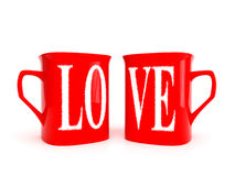 Two mugs with inscription love Stock Photography