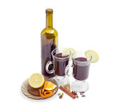Two mugs with mulled wine, bottle of wine, mulling spices Stock Photography