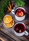 Two mugs of mulled wine on wooden table. Stock Photo