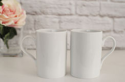 Two Mugs. White Mugs Mockup. Blank White Coffee Mug Mock up. Styled Photography. Coffee Cup Product Display.  Stock Photography