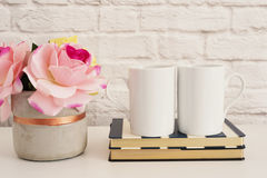 Two Mugs. White Mugs Mockup. Blank White Coffee Mug Mock Up. Styled Photography. Coffee Cup Product Display. Two Coffee Mugs On St. Riped Design Notebooks. Vase Royalty Free Stock Photo