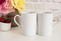 Two Mugs. White Mugs Mockup. Blank White Coffee Mug Mock Up. Styled Photography. Coffee Cup Product Display. Two Coffee Mugs On Wh. Ite Desk. Vase With Pink Royalty Free Stock Photography