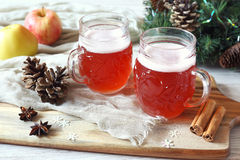 Two mugs of winter craft beer. And New Year decorations stock image