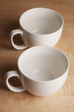 Two Mugs on Wooden Table Royalty Free Stock Image