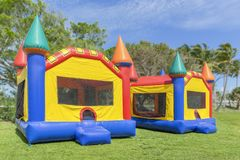 Two multi color castle bounce houses are ready for the kids stock photography
