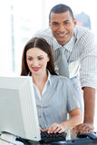 Two multi-ethnic colleagues working together Stock Photography