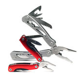 Two multi plier tools of different sizes. On a white Royalty Free Stock Photography