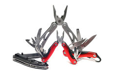 Two multi-tools and knives. On a white background Stock Photography