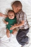 Two multiethnic boys brothers. Of mixed race one 3 months old and another 3 years Royalty Free Stock Photos