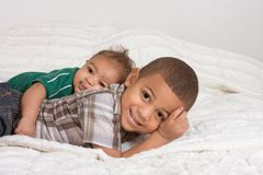 Two multiethnic boys brothers. Of mixed race one 3 months old and another 3 years Stock Images