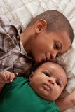 Two multiethnic boys brothers (focus on baby) Royalty Free Stock Photo
