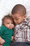 Two multiethnic boys brothers. Of mixed race one 3 months old and another 3 years Stock Photos