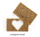 Two multigrain slices of bread with cut out shape of heart Stock Images