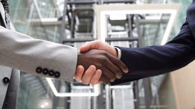 Two Multinational Business People Handshake. Greeting Deal Concept. Two Multinational Business People Handshake. Greeting Deal Concept stock video footage