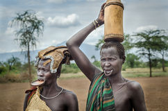 Two Mursi women, Omo Valley, Ethiopia. Mago National park, Ethiopia - August 10: two unidentified women from Mursi Tribe on August 10 2014. Mursi Woman wear lip Royalty Free Stock Image
