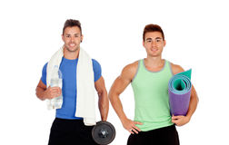 Two muscular men with gym equipment Royalty Free Stock Photography