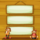 Two musical monkeys in front of the hanging signboards Stock Photo