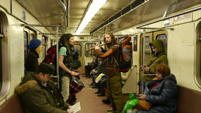 Two musician in the Moscow subway train singing and playing flute and drums. Two musician in the Moscow subway train sings and plays flute and drums. January stock video footage