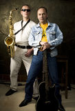 Two musicians Stock Images