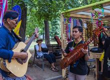 Moscow,Park on Krasnaya Presnya,August 05, 2018: two musicians from Indonesia with folk instrument royalty free stock image
