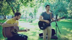 Two musicians playing in the street and give a good mood to the city. stock video footage