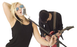 Two musicians singing and playing music Stock Photo