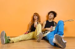 Two musicians sitting Royalty Free Stock Images