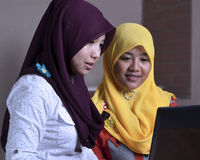 Two Muslim Girls with a laptop Royalty Free Stock Photos