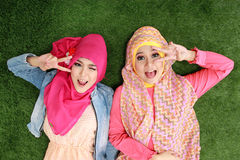 Two muslim woman lying on grass Stock Image