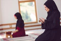Two Muslim women praying. Inside beutiful mosque Stock Photography