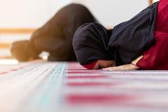 Two Muslim women praying. Inside beutiful mosque Royalty Free Stock Image