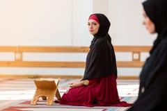Two Muslim women praying. Inside beutiful mosque Stock Image
