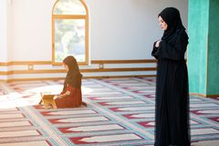 Two Muslim women praying. Inside beutiful mosque Royalty Free Stock Images
