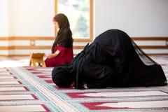 Two Muslim women praying. Inside beutiful mosque Stock Images