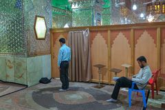Two Muslims perform Islamic worship in a mirror mosque, Iran. Royalty Free Stock Photo