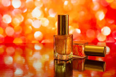 Two nail polish bottles on bright abstract red background with r Royalty Free Stock Photography